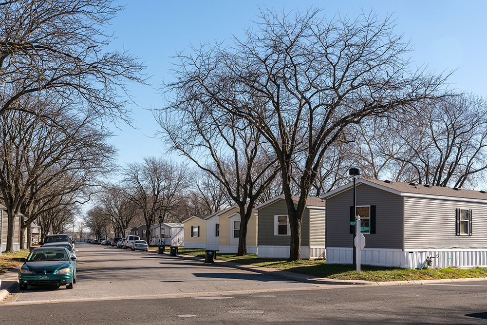 View down street of manufactured home community.